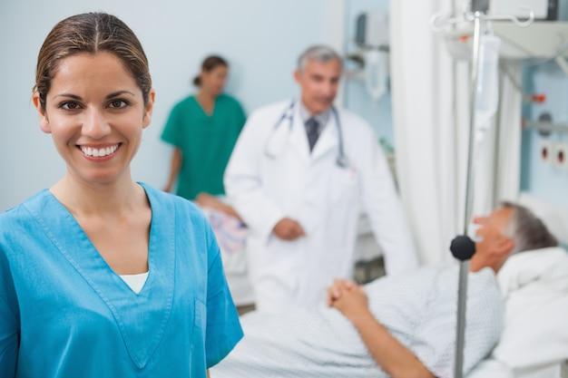 Happy nurse  in hospital room
