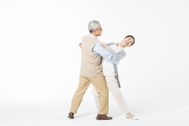 Happy old couples dancing isolate
