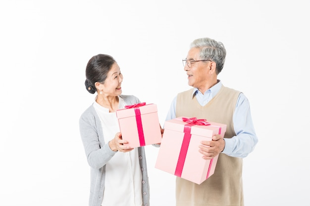 Happy old couples with gift boxes