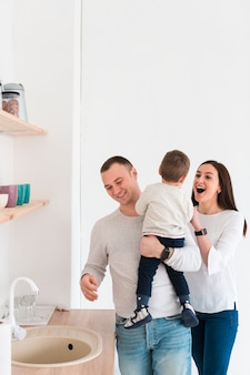 Happy parents with child in the kitchen