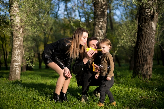 Happy parents with child in nature