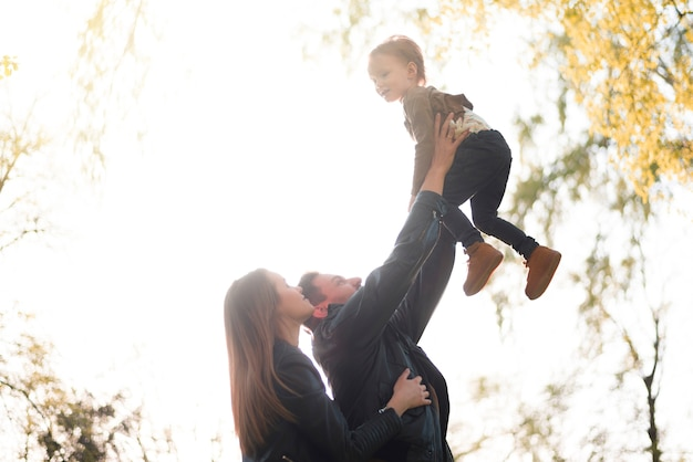 Happy parents with kid in nature