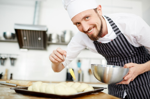 Happy pastry chef Free Photo