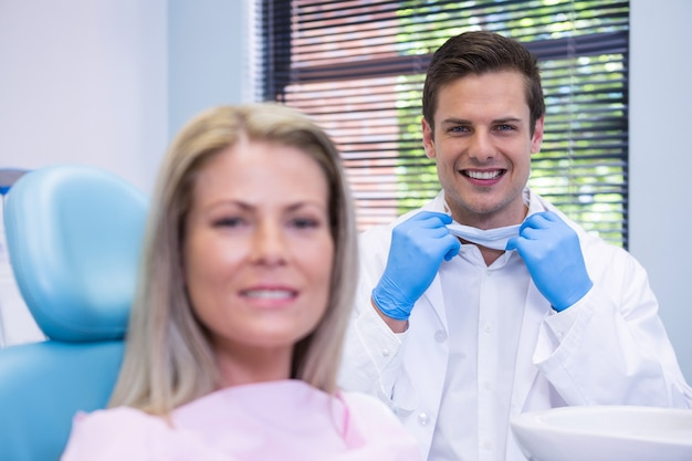Happy patient and dentist  at dental clinic