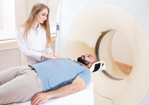 Happy patient undergoing mri scan at hospital.