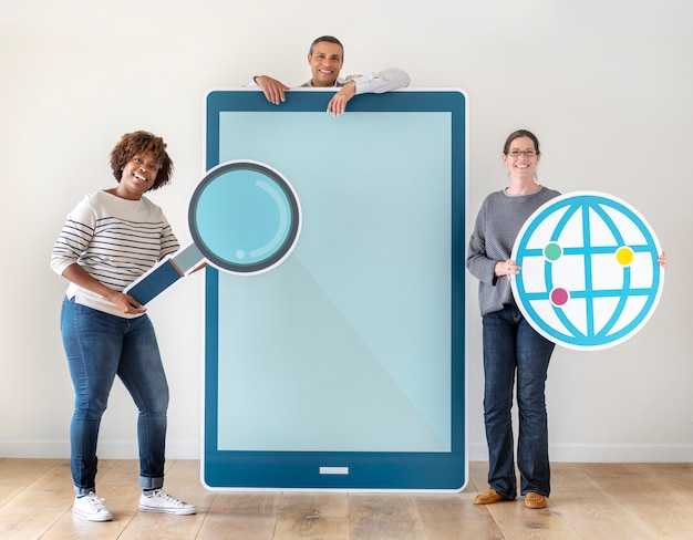 Happy people holding tablet with graphics