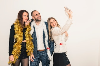 Happy people taking selfie with smartphone