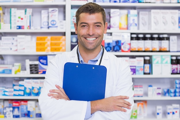 Happy pharmacist holding clipboard