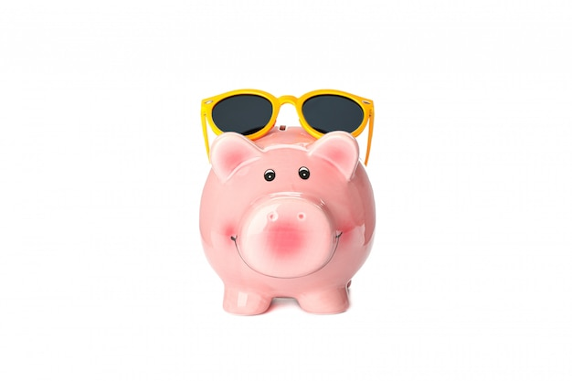 Happy piggy bank with sunglasses isolated on white background