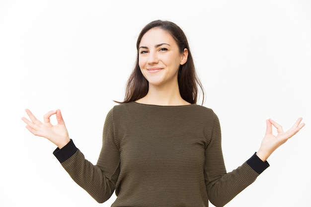 Happy positive female woman making zen gesture