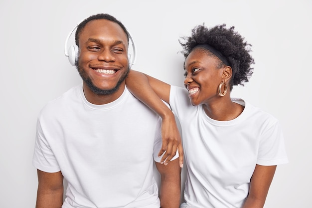 Happy positive friendly afro american teenage woman and man smile gladfully