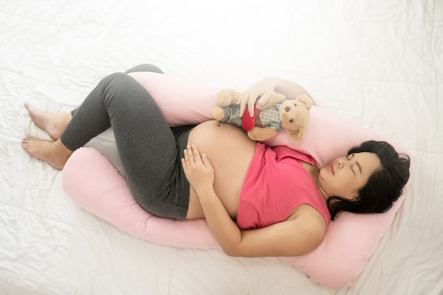 Happy pregnant woman and expecting baby.