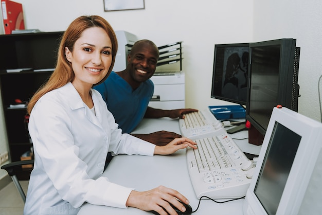 Happy radiology professionals analyzing scans