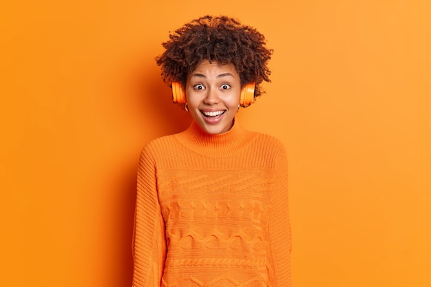 Happy reaction concept. overjoyed curly haired african american woman