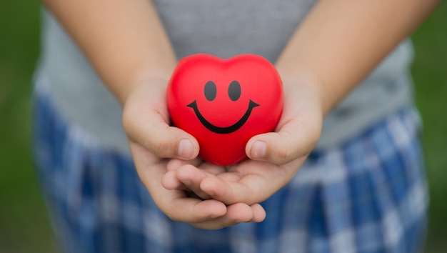 Happy red heart in the child's hand