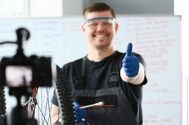 Happy repairer working on modern mountain bicycle