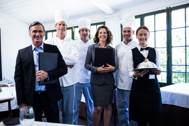 Happy restaurant team standing together in restaurant