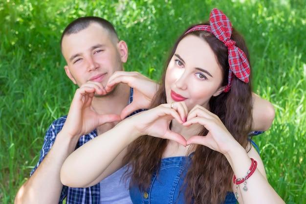 Happy romantic couple in love gesture heart.