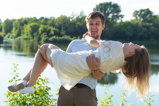 Happy romantic couple in love and having fun outdoor in summer day, beauty of nature, harmony concept.