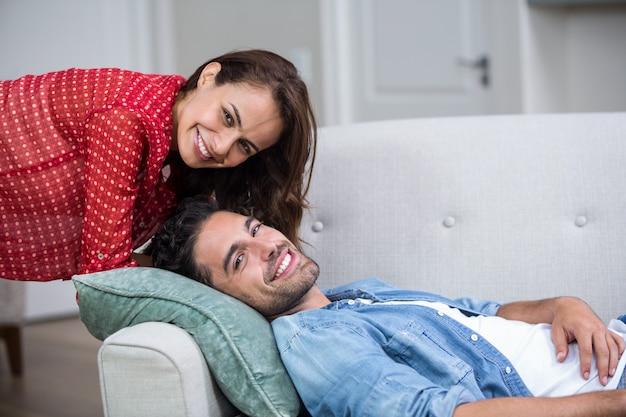 Happy romantic couple relaxing on sofa