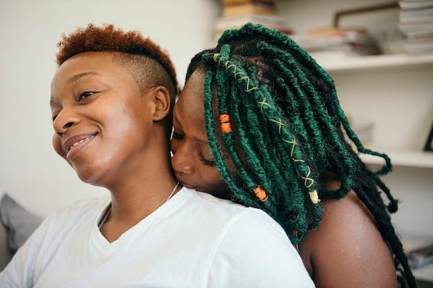 Happy romantic lesbian lover kissing