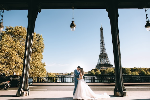Happy romantic married couple hugging near the eiffel tower in paris