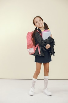 Happy schoolgirl. learning and school time concept.