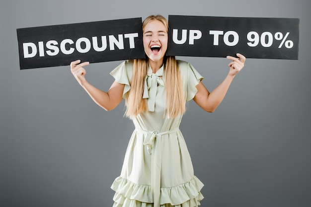 Happy screaming beautiful young woman with discount up to 90 sign isolated