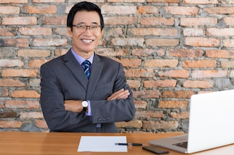 Happy Senior Business Man Relaxing at Office Desk
