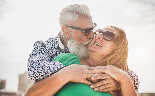Happy senior couple having tender moments outdoor durin holiday trip