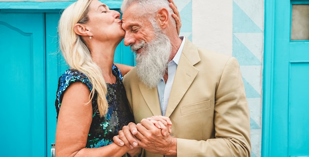Happy senior couple having tender moments outdoor - mature people enjoying time together