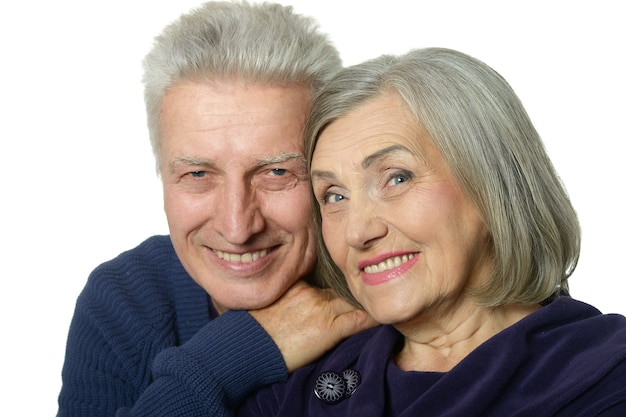 Happy senior couple isolated on a white background