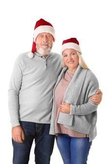 크리스마스 모자 배경으로 행복 한 고위 커플