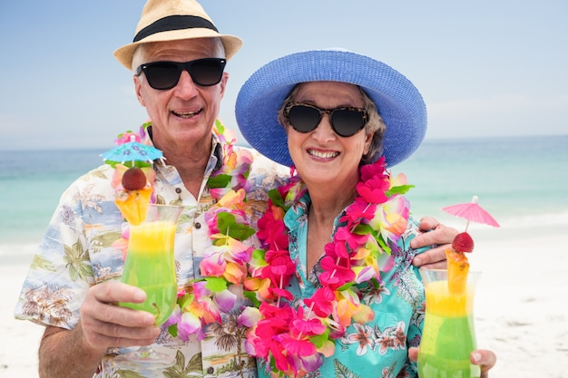 Happy senior couple with a cocktail drink