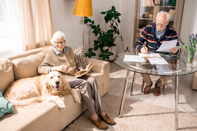 Happy senior couple with family pet