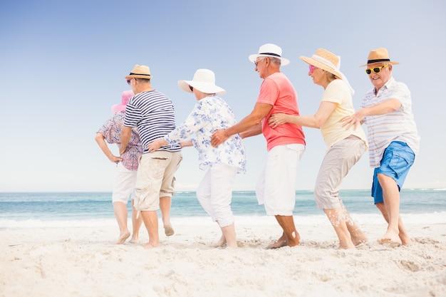 Happy senior friends dancing
