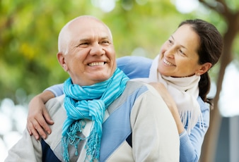 Happy senior man and smiling mature woman