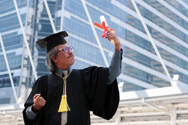 Happy senior man in his graduation day.