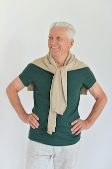 Happy senior man on a white background