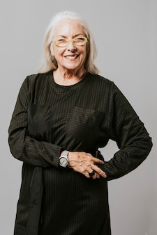 Happy senior woman in a studio