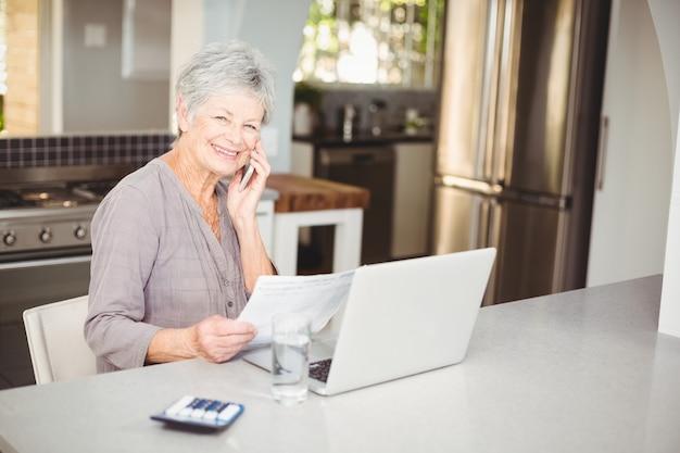 Happy senior woman talking on mobile phone