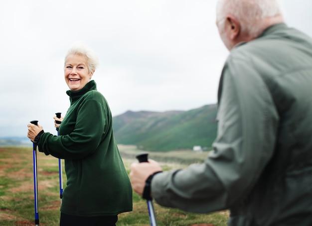 Happy seniors with trekking poles