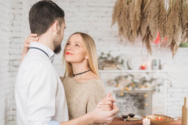 Happy sensual couple dancing indoors