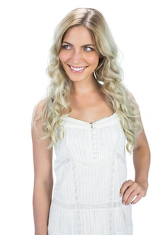 Happy sensual model in white dress posing