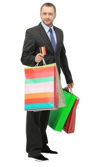 행복 한 쇼핑 남자입니다. 흰색 배경 위에 절연