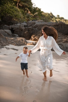 Happy smile european family have rest and run on white sand beach.