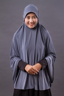 Happy smiling asian muslim woman studio isolated