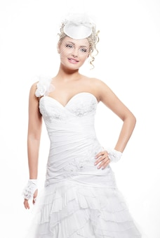 Happy smiling beautiful bride in white wedding dress with hairstyle and bright makeup