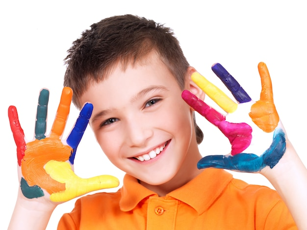Happy smiling boy with a painted hands - isolated on white.