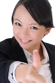 幸せな笑顔のビジネスの女の子の親指、白い背景の上のクローズアップの肖像画。